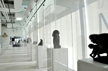 The museum's bright, white space is meant to evoke the feeling of being on the tundra. Displayed here, the sculptures of artists Abraham POV, John Tiktak and Osuitok Ipeelee. (PHOTO BY SARAH ROGERS)