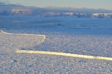 This 28-square kilometre ice island fragment is surrounded by ice floes off Ellesmere Island. (PHOTO BY J.E.TREMBLAY/ARCTICNET)