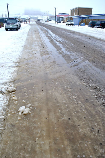 Iqaluit's thawing and re-freezing streets have produced hazardous conditions for vehicles this week. (PHOTO BY JIM BELL)