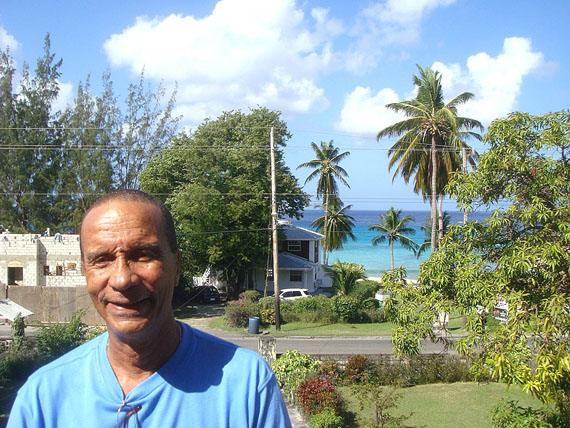 Like many people in Barbados, Al Sealy sees many impacts of climate change, which contributes to rising sea levels and even higher crime on the island. Surging waves brought seawater up to the door of his rental property, the first time in his 66 years that he had seen something like that happen. (PHOTO BY JANE GEORGE)