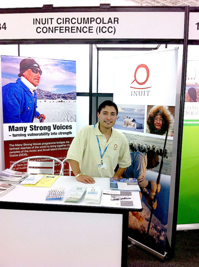 Kirt Ejetsiak of Iqaluit, vice-president of the Inuit Circumpolar Council, sits at the booth of Many Strong Voices, a coalition between small island nations and Arctic organizations, at last December's United Nations climate change conference in Cancun. (PHOTO COURTESY OF ICC)