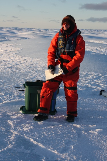 Here researcher Anna Crawford records information on Petermann Ice Island in Lancaster Sound in October 2011. (PHOTO COURTESY OF A. CRAWFORD)