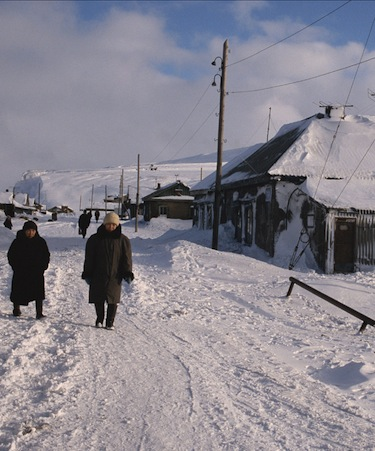 Women walk down the snowy streets of Uelen in Russia's Arctic. (FILE PHOTO)