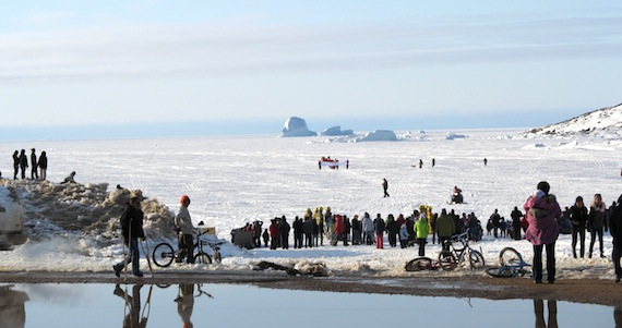 "People in Qikiqtarjuaq wait on the shore and ice to greet the returning walkers who embarked on a three-day walk to support suicide prevention efforts. ""They were walking to show their love to Nunavummiut especially Pangnirtung people, to show friendship and healing and to prevent suicide,"" said Morris Kuniliusee said. (PHOTO BY M. KUNILIUSEE)"