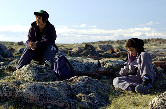 Uvanga characters Travis (left) played by Travis Kunnuk and Tomas (Lukasi Forrest) reflect at the site of their father's death in the new Arnait Video Productions film. (PHOTO COURTESY OF ARNAIT PRODUCTIONS)