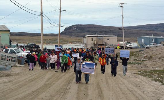 More than 100 people who took to the streets of Clyde River _ and in communities across the territory - July 23 to protest plans for seismic testing in Baffin Bay and David Strait. (PHOTO BY NICK IILAUQ)