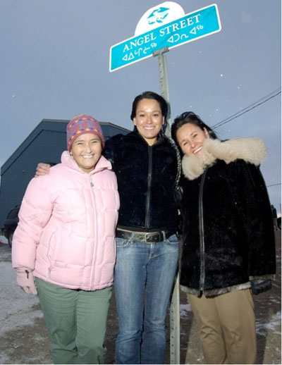 "Elisapee Sheutiapik, far left, celebrates the inauguration of Angel Street in Iqaluit during her term as the city's mayor in 2007 with musician Lucie Idlout and Leona Aglukkaq, current MP for Nunavut. The street, and Sheutiapik's ""Angel Street Project"" to raise awareness about domestic abuse, took its name from a Idlout's song ""Lovely Irene,"" which was also released as ""Angel Street."" (PHOTO COURTESY CITY OF IQALUIT)"