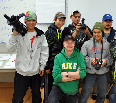 Gordon Billard, in green, is pictured with members of the Arviat Film Society during one of the group's meetings in his classroom last fall. (PHOTO BY SARAH ROGERS)