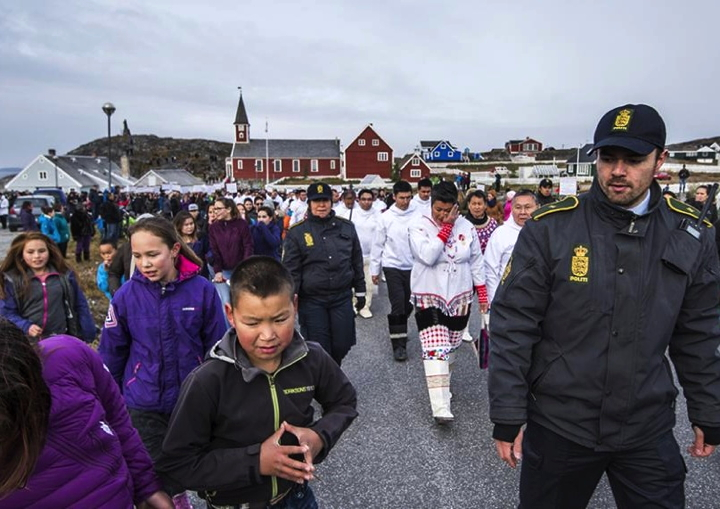 Greenland's then-premier Aleqa Hammond walks through protesters in Nuuk's old town Sept. 30 on her way to open the first day of parliament's autumn sitting. (PHOTO BY LEIFF JOSEFSEN/ SERMITSIAQ AG)