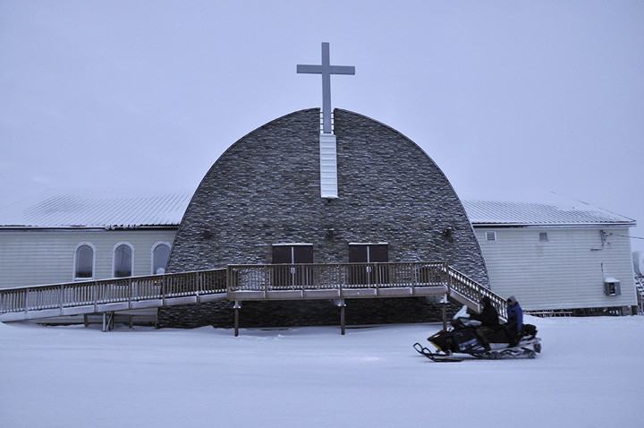 The cross on the new St. Stephen's Catholic Church in Igloolik looms large. Following a coroner's inquest in that community, RCMP say they are now undertaking a comprehensive review of recommendations from jury members. (PHOTO BY THOMAS ROHNER)