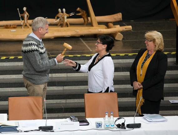Sweden's Minister of Foreign Affairs Carl Bildt hands over the ceremonial gavel to Nunavut MP Leona Aglukkaq, Canada's minister responsible for the Arctic Council, May 15, 2013 at the Arctic Council ministerial meeting in Kiruna, Sweden. That marked the transfer of chairmanship of the Arctic Council to Canada. In Iqaluit she will hand over the gavel to U.S. Secretary of State John Kerry. (FILE PHOTO)