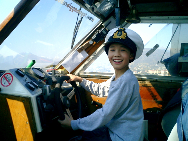 Captain Eric at the helm on Lago Maggiore in Northern Italy, 2005. He was 10 years old. (PHOTO COURTESY DAVID PELLY)