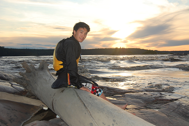 Eric Ayalik Okalitana Pelly takes a break after a day of whitewater kayaking on the Slave River 2011. (PHOTO BY RITA ANTONIAK)
