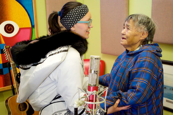 Elders teaching youth: Qaunaq Mikigak, the renowned throat singer from Cape Dorset, teaches Julie Alivaktak how to throat sing. (PHOTO COURTESY OF QAGGIAVUUT SOCIETY)