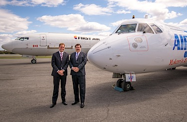Bert van der Stege, Vice President Commercial at First Air, stands with Joe Sparling, President of Air North, in front of their respective company jets in a photo released May 11. (HANDOUT PHOTO)