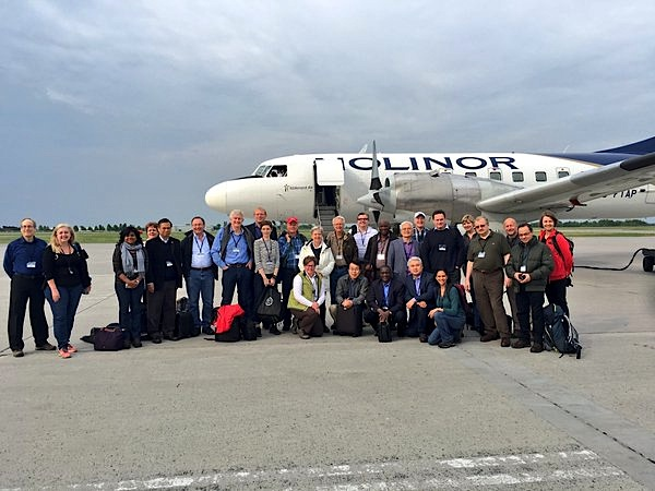 In this photo, widely posted on Twitter, more than 20 ambassadors, high-ranking diplomats and officials stand May 29 in front of the Nolinor/Kitikmeot Air charter which will take them from one end of the Arctic to the other during a nine-day northern tour.