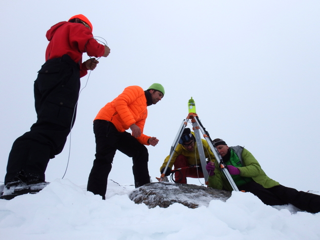 A team consisting of staff from Oceans North and the Université du Québec à Rimouski painstakingly install a tripod to mount a camera at Mt. Herodier near Pond Inlet. The camera is now sending images to a website to show local community members current weather and ice conditions in Eclipse Sound. (PHOTOS COURTESY OCEANS NORTH)