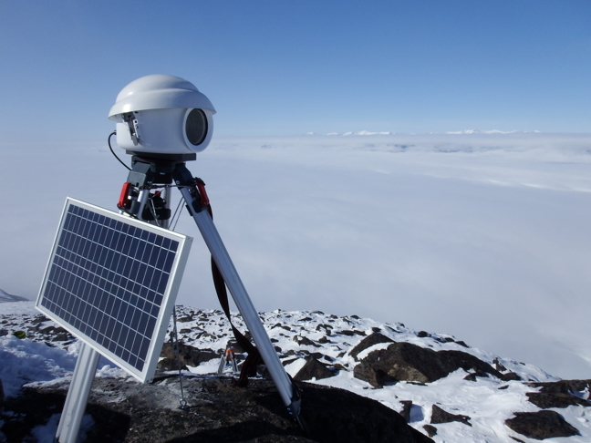 The camera, atop Mt. Herodier about 30 kms east of Pond Inlet on North Baffin Island, is enclosed in a plastic casing and powered by a solar panel and lithium-ion battery pack.