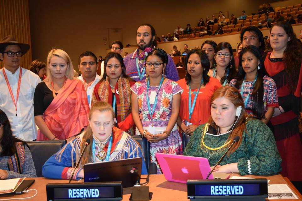 At the UN Permanent Forum for Indigenous Issues held in New York City May 11: Ida Ristiinná Hætta Ophaug, a Saami youth from Kautokeino, Norway, reads a statement from the Global Indigenous Youth Caucus while caucus representative Sarah Jancke of Cambridge Bay, vice president of the Inuit Youth Council, looks on from the right.  (PHOTO COURTESY OF THE UNPFII)