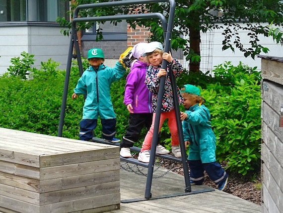 A group of older kids at the Máttabiegga Giellabeassi language nest play outside their day centre located close to the heart of Helsinki in southern Finland. (PHOTO BY JANE GEORGE)