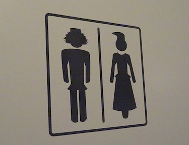 The images on the bathroom door of the Máttabiegga Giellabeassi language nest show silhouettes of men and women in traditional Saami outfits. (PHOTO BY JANE GEORGE)