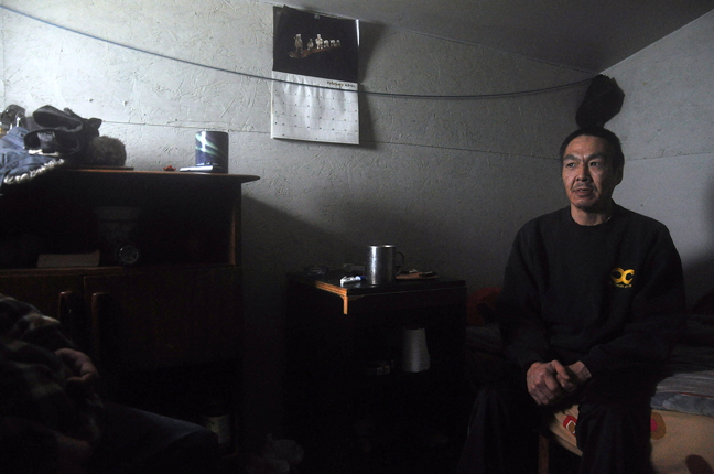 Nushupiq Kilabuk inside the modest but sturdy shack he built for himself on the Iqaluit beach front. Kilabuk has been on and off homeless until he built himself his own shelter. The Nunavut government says it is hoping to devise a short term homelessness plan that could include cooperative or co-housing options. (PHOTO BY THOMAS ROHNER)