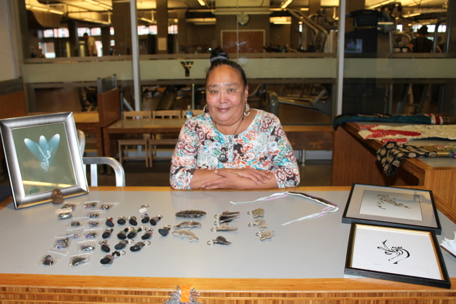 Okeejuasee Sageatook shows off some lucky sealskin keychains and other items she had for sale at a recent arts and crafts fair in Ottawa organized by Tungasuvvingat Inuit. (PHOTO BY KELLY BUELL)