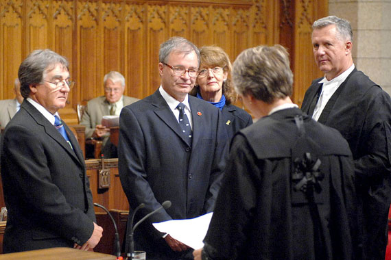 Dennis Patterson takes his oath of office in the Senate chamber on Sept. 15, 2009, as Senator Charlie Watt, Marjory LeBreton, then the Senate government leader, and Mark Audcent, a Senate law clerk, look on. At the time, Patterson promised he would quit in eight years, but the Senate reform package the promise was attached to was killed by the Supreme Court of Canada and Patterson now says he'll keep the job until he reaches age 75 in 2023. (PHOTO BY DENNIS DREVER)
