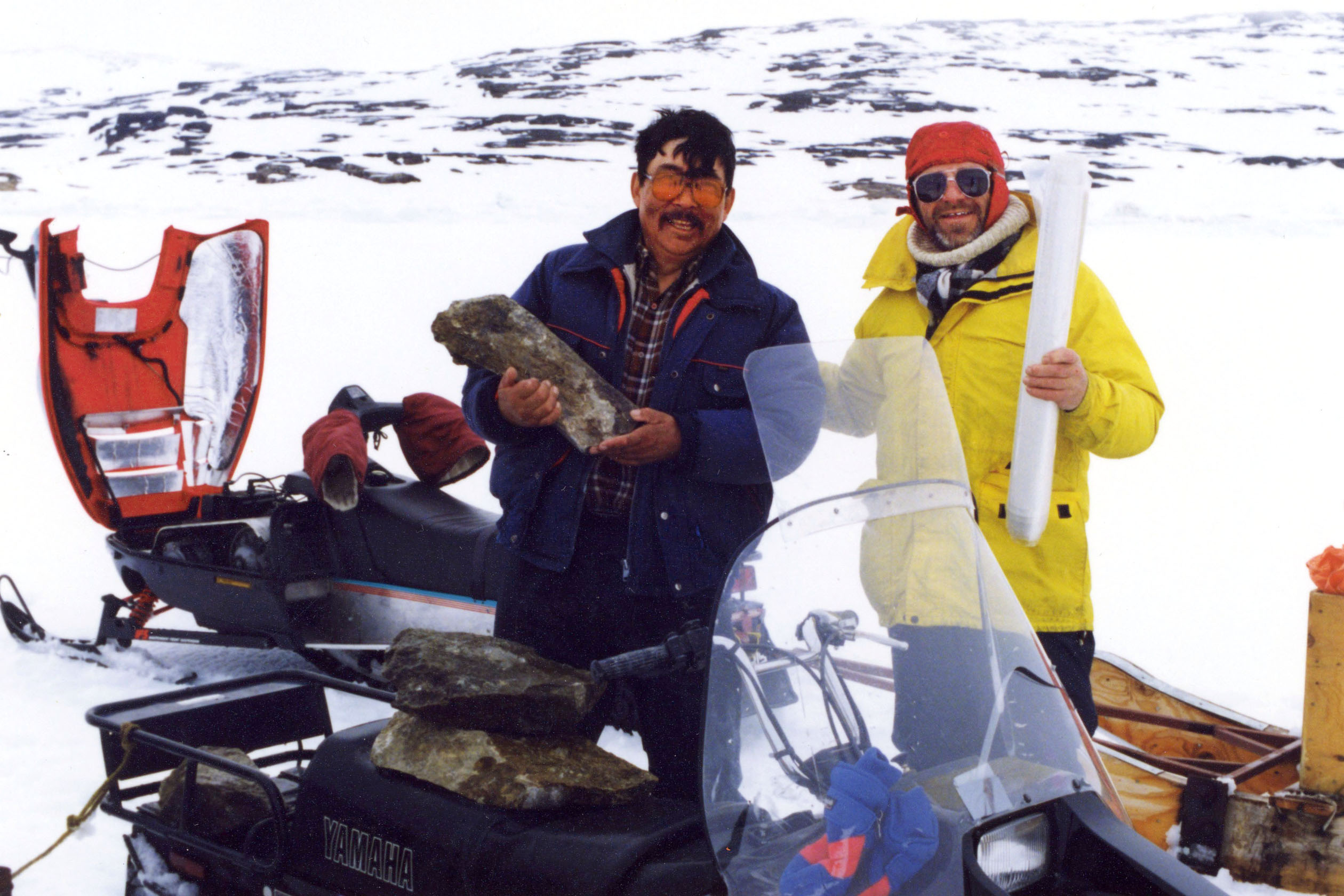 "The late Tom Webster fetching soapstone with Iola Ikkiidluak of Kimmirut. A ""come-and-go"" reception in recognition of Tom Webster will be held at the Nunatta Sunakkutaangit Museum in Iqaluit from 1:30 p.m. to 2:30 p.m. on Thursday April 20. (PHOTO COURTESY OF KENN HARPER)"