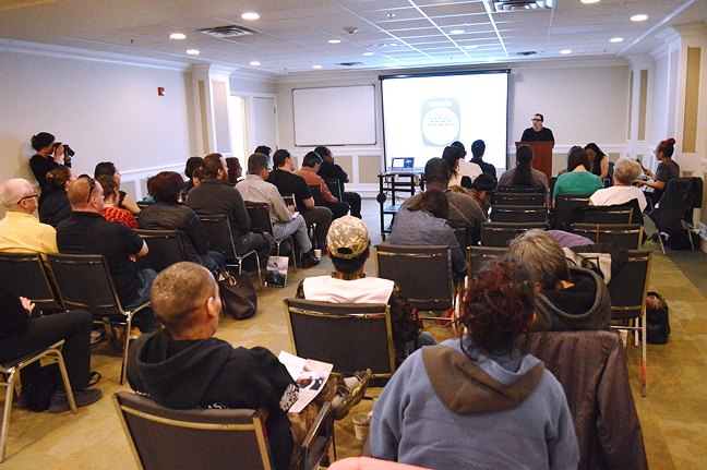A crowd gathers at Iqaluit's Hotel Arctic July 7 to hear details of the new Inuit-controlled